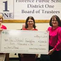 Duke Energy Foundation presents $5,000 check to The School Foundation